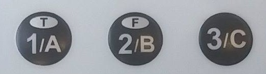 the 1 A, 2 B, and 3 C buttons at the top row of the clicker, with T on 1 A and F on 2 B